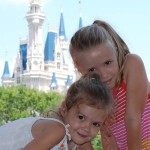 Grace and Trinity St.Pierre climbing Tomorrowland rocks at Disney's Magic Kingdom