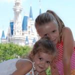 Grace and Trinity St.Pierre climbing Tomorrowland rocks at Disney's Magic Kingdom