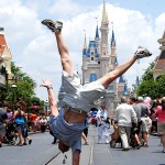 Daniel St.Pierre puling a handstand on Main Street, USA at Disney World