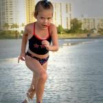 Trinity Running on Sand Key Beach